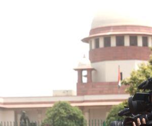 :New Delhi: Senior Advocate Abhishek Manu Singhvi talks to the press after a hearing on Karnataka Governor Vajubhai Vala's decision to appoint K.G. Bopaiah, a relatively junior MLA, as the ...