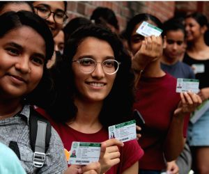 New Delhi: Students queue up with their identity cards to cast their votes for the Delhi University Students Union (DUSU) elections, at Miranda House College in North Campus, in New Delhi on Sep 12, 2019. (Photo: IANS)