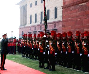 General Sher Mohammad Karimi inspects the Guard of Honour