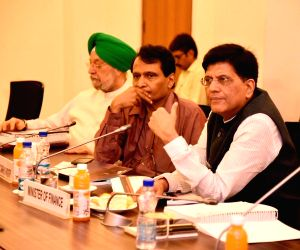 :New Delhi: Union Finance Minister Piyush Goyal, Union Commerce and Industry Minister Suresh Prabhu and Union MoS Housing and Urban Affairs Hardeep Singh Puri during a meeting on Make in India ...