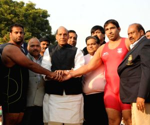 Rajnath Singh witnesses a wrestling match at Grand Wrestling Championship