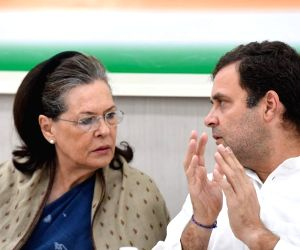 New Delhi: UPA Chairperson Sonia Gandhi in a conversation with her son and Congress President Rahul Gandhi during the Congress Working Committee (CWC) meeting at the party's headquarters in New Delhi, on May 25, 2019. (Photo: IANS)