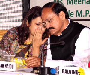 Urban Development Minister M. Venkaiah Naidu presents DDA allotment letter