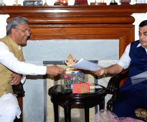 New Delhi: Uttarakhand Chief Minister Trivendra Singh Rawat meets Union Minister for Road Transport and Highways and Micro, Small and Medium Enterprises Nitin Gadkari, in New Delhi on June 15, 2019. (Photo: IANS/PIB)