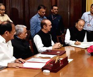 : New Delhi: Vice President and Rajya Sabha Chairman M. Venkaiah Naidu administers the Oath of Office and Secrecy to the re-elected Member of Rajya Sabha and Union Finance and Corporate Affairs ...