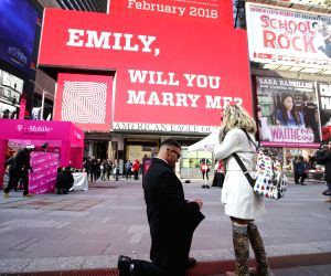 "NEW YORK, Feb. 14, 2018 - Joseph Lodato (L) proposes to Emily Gambarella during the ""Surprise Proposal"" Valentine's Day event at Times Square in New York, the United States, on Feb. 14, ..."