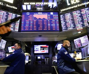 NEW YORK, Nov. 13, 2018 - Traders work at the New York Stock Exchange in New York, the United States, Nov. 12, 2018. U.S. stocks closed sharply lower on Monday, as steep losses in Apple shares led ...