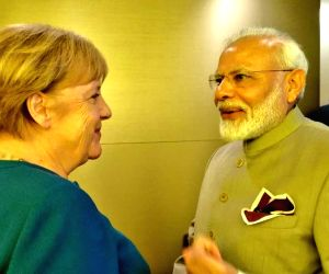 New York: Modi holds bilateral with Angela Merkel