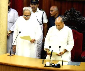 Odisha Assembly Pro-tem Speaker Amar Prasad Satpathy administers oath to Chief Minister Naveen Patnaik as the Member of Odisha Legislative Assembly, in Bhubaneswar on May 30, 2019.