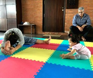 On International Yoga Day on Friday, actor Kunal Kemmu shared an adorable photograph of his daughter Inaaya Naumi Kemmu trying yoga under the guidance of her grandmother. Kunal on Friday shared a photograph on Instagram, where little Inaaya is seen t