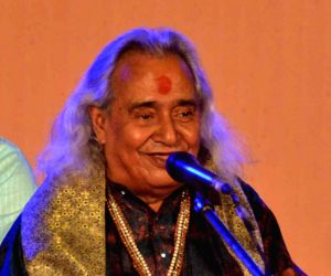 Pandit Channulal Mishra performs during a programme
