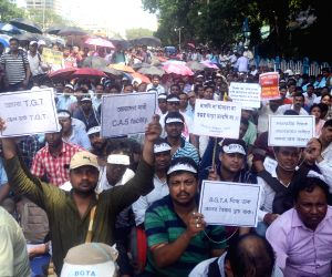 Para-teachers stage a sit-in demonstration against the West Bengal Government, in Kolkata on Aug 30, 2019.