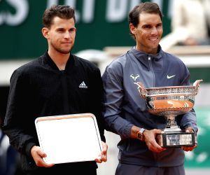 PARIS, June 10, 2019 - Rafael Nadal (R) of Spain poses with Dominic Thiem of Austria during the awarding ceremony after their men's singles final at French Open tennis tournament 2019 at Roland ...