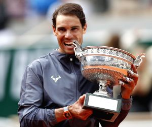 PARIS, June 10, 2019 (Xinhua) -- Rafael Nadal of Spain poses during the awarding ceremony after the men's singles final against Dominic Thiem of Austria at French Open tennis tournament 2019 at Roland Garros, in Paris, France on June 9, 2019. Nadal w