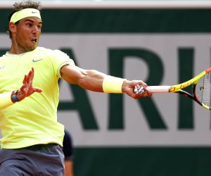 PARIS, June 9, 2019 (Xinhua) -- Rafael Nadal of Spain competes during the men's singles final with Dominic Thiem of Austria at French Open tennis tournament 2019 at Roland Garros, in Paris, France on June 9, 2019. (Xinhua/Han Yan/IANS)