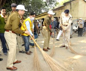 Activists and police officers participate in Swachha Bharat Abhiyan