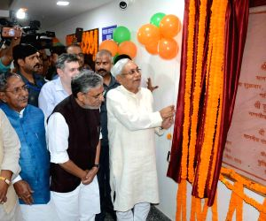 : Patna: Bihar Chief Minister Nitish Kumar accompanied by Deputy Chief Minister Sushil Kumar Modi unveils the foundation stone of a new state police headquarter named after Sardar Vallabh Bhai Patel ...