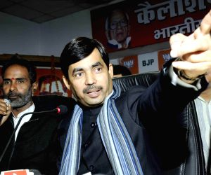 Shahnawaz Hussain addresses a press conference