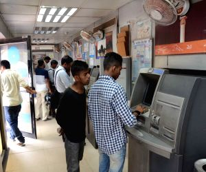 Patna: People at a State Bank of India ATM during the nationwide bank strike spearheaded by the United Forum of Bank Unions (UFBU), an umbrella body of nine unions; in Patna on May 31, 2018. The bankers are striking work demanding early revision of t