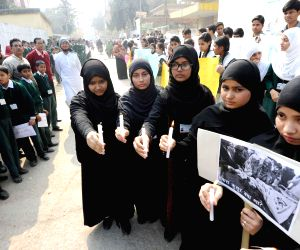 Candlelight vigil to condemn attack on Peshawar school
