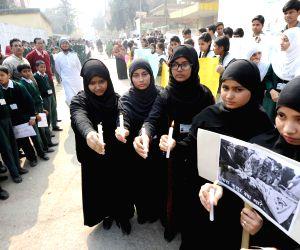 Candlelight vigil to condemn attack on Peshawar school