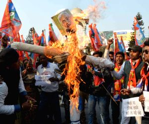 People burn an effigy of Bihar Chief Minister Nitish Kumar to protest against the ban on fish sales in Patna after formalin and lead were found in fish samples; in Patna, on Jan 16, 2019.