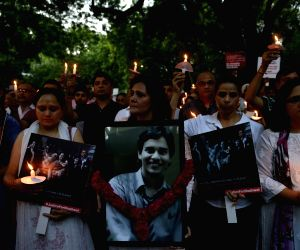 People hold candle light march for Dr. Shashwat Pande