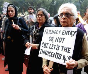 People demand justice in the sensational Aarushi-Hemraj double murder case at Jantar Mantar in New Delhi on Dec.22, 2013.
