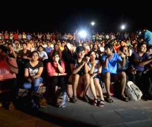 People watch Sindhu play against  Carolina Marin