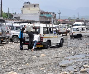 Rains leave taxi stand at Rispana river flooded