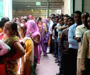 MCD Polls  - People queue up outside