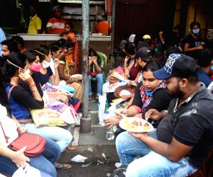 People shopping at New market area on eve of Durga Puja festival