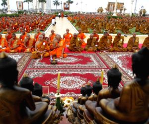 People pray in front of the Royal Palace in Phnom Penh