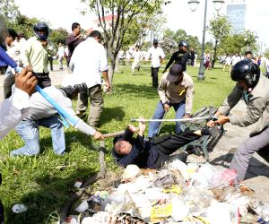 Phnom Penh:A security guard is seriously beaten during a clash near the Freedom Park in Phnom Penh, Cambodia