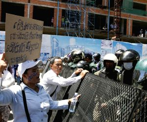 Phnom Penh: Opposition supporters rally outside the court in Phnom Penh, Cambodia