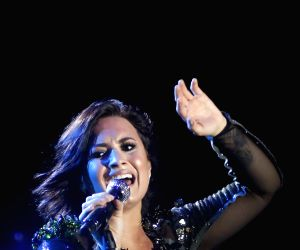 Demi Lovato performs as 'new person with a new life'