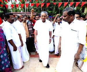 Pinarayi Vijayan CPI-M candidate for Dharmadam constituency during an election campaign ahead of the Kerala Assembly polls in Kannur on April 16, 2016.