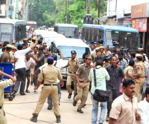Police arresting YSR Congress activists in Hyderabad