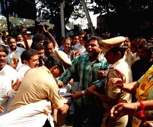 Policemen arrest protesters demonstrating against humiliation of Devyani Khobragade