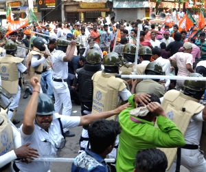 Police charge batons on BJP workers