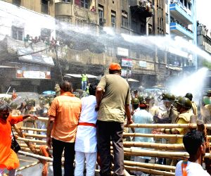 Police charge water cannons on BJP workers