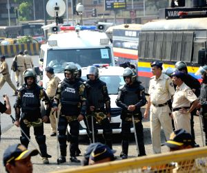 Police personnel during 'Elgaar march' organised to press for the arrest of rightist leader and Shiv Pratishthan chief Sambhaji Bhide in connection with Bhima-Koregaon riots; at Azad Maidan ...