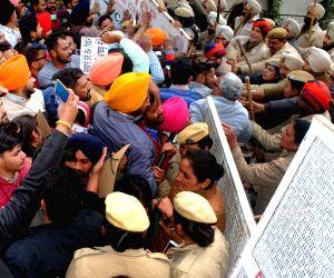 Police stops unemployed teachers staging a demonstration against the Punjab Government, under the banner of Unemployed Elementary Teacher Training (ETT)- Teacher Eligibility Test (TET) Pass ...