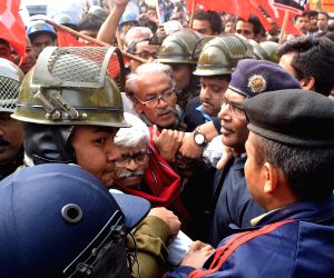 Police takes away CPI leader Sujan Chakraborty during a demonstration by Trade Union members on the second day of the two-day long nationwide strike called by central trade unions against ...