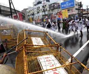 Police use water canons to disperse Congress workers protesting against alleged involvement of a top CPI-M leader's son in giving government land to a private group to start a brewery in ...