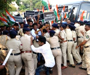 Policemen prevent Congress workers staging a protest outside Central Bureau of Investigation (CBI) office against the central government's move to strip CBI Director Alok Verma of his power ...