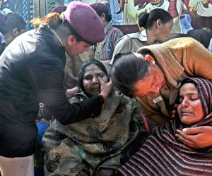 Policewoman console grief struck relatives of factory fire victims