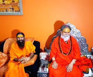 Prayagraj: Yoga Guru Baba Ramdev meets Akhil Bharatiya Akhara Parishad (ABAP) president Mahant Narendra Giri at Math Bagambari Gaddi in Prayagraj on Aug 7, 2019. (Photo: IANS)