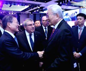 President Moon Jae-in with N. Korean IOC member