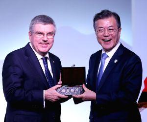President Moon Jae-in with IOC head